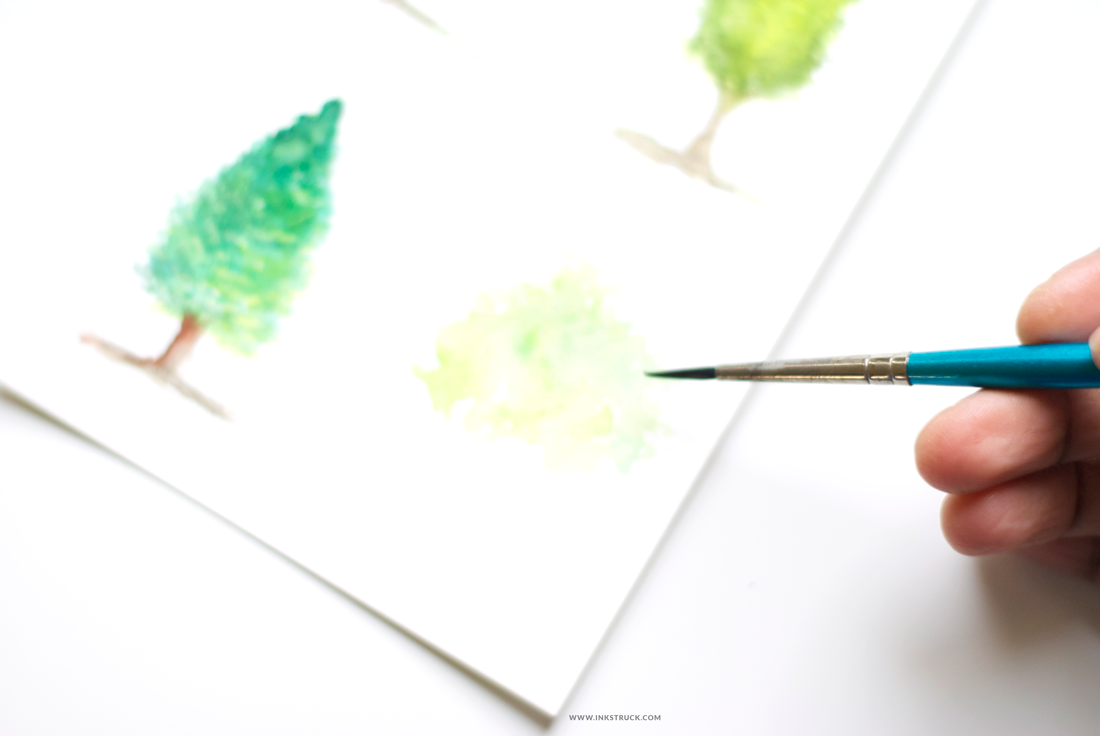 Learn how to paint watercolor trees in this tutorial by Zakkiya Hamza of Inkstruck Studio.