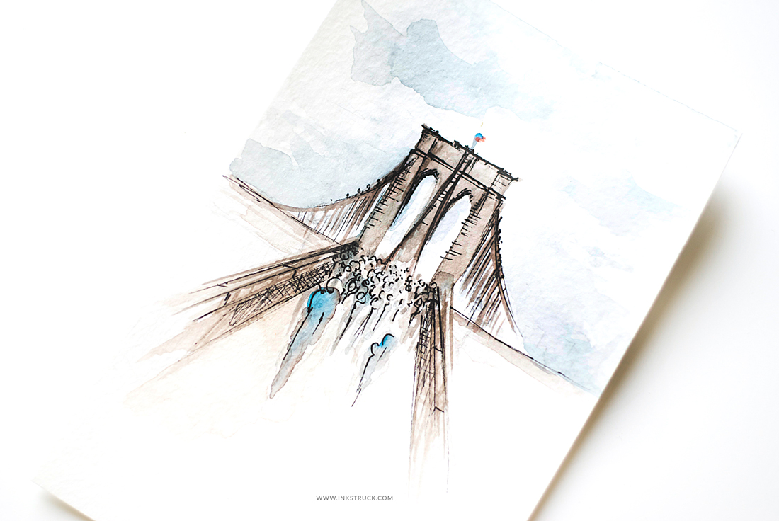 Learn how to paint the beautiful Brooklyn bridge in this watercolor streetscape painting tutorial by Zakkiya Hamza of Inkstruck Studio.