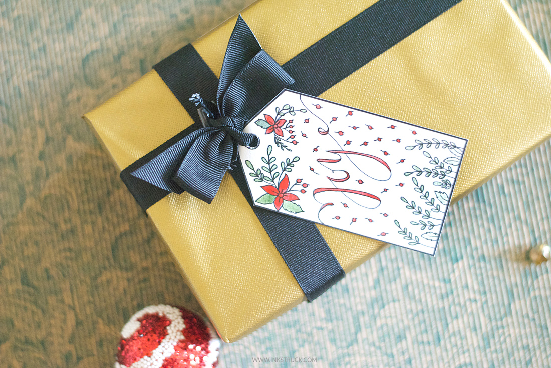 Download free printable Christmas gift tags that you can color by Zakkiya Hamza of Inkstruck Studio.
