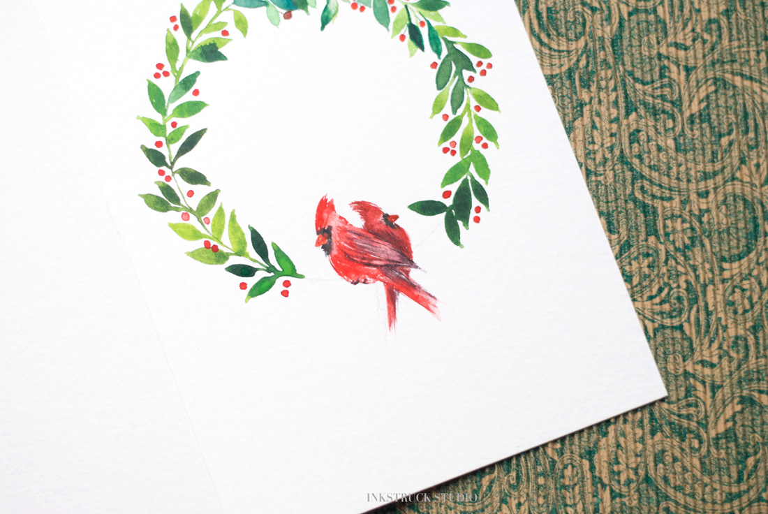 Learn how to create a DIY watercolor christmas wreath greeting card in this tutorial by Zakkiya Hamza of Inkstruck Studio