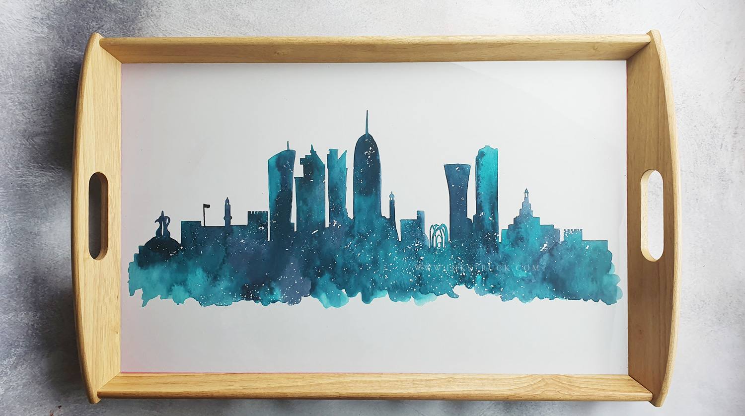 Doha skyline watercolour print on a tray by Zakkiya Hamza of Inkstruck Studio